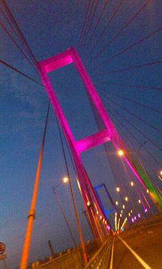 Suramadu Bridge, the bridge that connects Surabaya and Madura. Changing colors lighting made the bridge looks stunning at night.