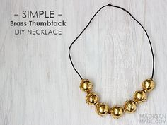 Simple brass thumbtack and hardware DIY necklace