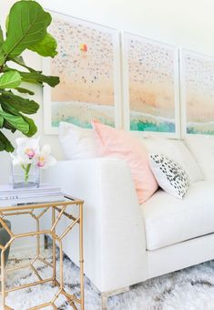 Beach Aerials from La Plage Collection by Gray Malin above Couch.