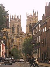 Architecture of the medieval cathedrals of England - The pinnacled western towers of York Minster rise above the townscape.