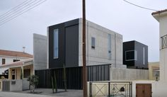 Architecture, Appealing Minimalist Townhouse 0605 Project By Simpraxis Architects Featuring Exterior Design With Concrete Wall, Window Glass And Steel Fence: Gothic Young Family House with Minimalist Family House Style