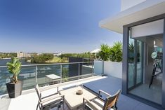 This simple glass balustrade provides an elegant safety barrier for this top floor balcony with great views – Stock image Planning A Move, Glass Balcony, Juliet Balcony, Laminated Glass, Glass Balustrade, Safety Glass, France, Great View, Sun Lounger