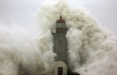 Estela Silva/EPA The lighthouse at the mouth of the River Douro, Porto, Portugal is engulfed in a huge wave. Giant Waves, Huge Waves, Porto Portugal, Biarritz, Perfect Timing, Life Is Strange, Belle Photo, Cn Tower, Coastal