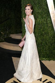 Alison Williams in classic white Valentino with a cool brocade-ish texture.
