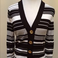 "MICHAEL KORS Black White Striped Cardigan Sweater MICHAEL KORS Black White Striped Cardigan Sweater Gold Button Petit Medium P/M. In excellent used condition! Very cute black and white striped with gold Michael Kors branded buttons. Soft ribbed material. 75% rayon/25% nylon. Clean and comes from smoke free home. Questions welcomed! Measurements lying flat/measured across: Length: 23.5"" Armpit to armpit: 16""  Sleeve length: 23"" Michael Kors Sweaters Cardigans"