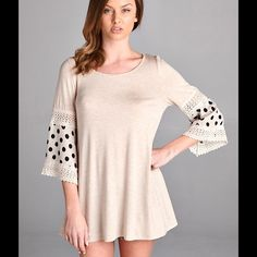 Adorable Oat Polka Dot Tunic!! This adorable top is oat color with black polka dots & lovely lace details on the 3/4 sleeves. You can wear it as a top or a mini dress! Size 2X. Rayon & Spandex. No trades or PayPal.  Boutique Tops