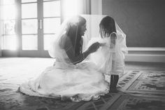 """Why We Love It:This photo with the flower girl is absolutely precious. Fun idea: Frame it and give it to your flower girl on her own wedding day!Why You Love It: """"Sweet moment! I want a picture like this with my daughters!"""" —Lacy G. """"Love it —just precious!"""" —Shantei H. """"So beautiful! Love this!"""" —Long Island Wedding"""