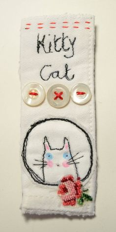 BROOCH or Pin - free machine embroidered Kitty Cat Hello and welcome to my Etsy listing. Here we have a brooch or pin, with my Kitty design free