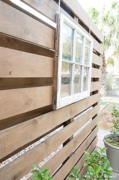Beautiful!! How to build a DIY privacy wall to polish off your outdoor space and provide needed privacy. www.tableandhearth.com