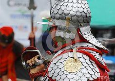 RUSSIA, MOLODI VILLAGE - JULY 27: Unidentified man  in armor on event dedicated to Victory in battle near the Molodi village 1572, on July 27, 2013, in Moscow region, Russia Мужчина в латах и шлеме