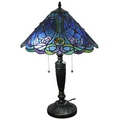 Handcrafted from 360 glass pieces and 70 pearls, this blue table lamp would be the perfect addition to your home decor. This lamp contains intricate detail and would illuminate your room with beauty.