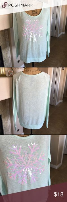 """🆕 Listing!! Snowflake Sweater This isn't a heavy sweater, so you might want to wear a long sleeve top under it depending on where you live. The color is mint green and it features a large snowflake on front! The snowflake is made of gorgeous iridescent sequins! The bust measures approx 44"""" and the length 24"""". It is in great condition! Everything I sell is from my real closet or family members. Nothing was purchased at a discount. Sweaters"""