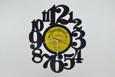Vinyl Record Album Wall Clock artist is by vinylclockwork on Etsy, $23.00