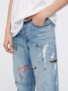 Painted Boyfriend Jeans | Boyfriend fit jeans low-rise featuring hand-painted paint splatter detailing.    * Due to the hand-painted technique, each pair will feature isn't own unique design.   * Authentic no-stretch cotton fabric.   * Button fly.   * Five-pocket style.