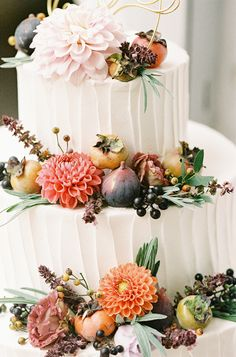 Autumn wedding cake featuring figs, wild grapes, persimmons, lavender, basil flowers, rose hips, and dahlias.  Grown and designed by Love 'n Fresh Flowers.  Photo by Maria Mack Photography.