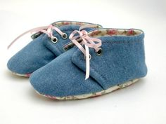 These lace up shoes are made from a lightweight cotton denim outer fabric with contrasting pink floral cotton lining and matching pink satin ribbon