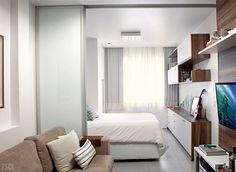 Móveis planejados integram ambientes em quitinete de 26 m²