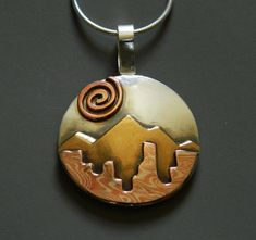 Mixed metal jewelry mokume gane silver by EvolveJewelryStudio