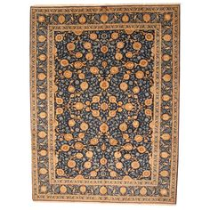With a distinctive style, a gorgeous area rug from Iran will add some splendor to any decor. This Isfahan area rug is hand-knotted with a floral pattern in shades of navy, ivory, beige, turquoise, and brown.
