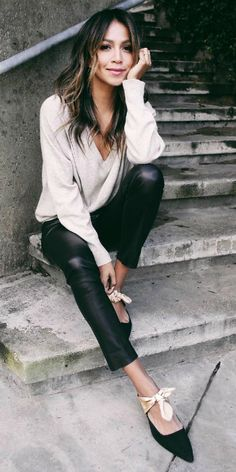 Julie Sarinana + pair of leather leggings + V neck blouse + ballet style flats + monochrome chic spring style.   Brands not specified.