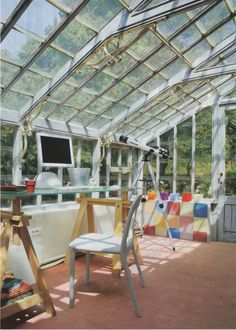 We love the conservatory feel of this home office - look at those windows!!