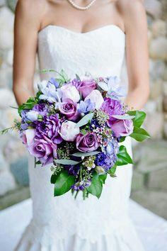 Beautiful Bridal Bouquet Comprised Of: Purple Dahlias, Purple Chrysanthemums, Purple Roses, Light Pastel Pink Roses, Blue/Purple Hydrangea, Light Blue Florals, Green Seeded Eucalyptus & Other Greenery/Foliage