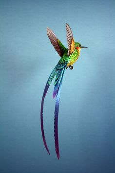 Handmade paper and wood long tailed hummingbird sculpture, available to buy here: www.etsy.com/shop/ZackMclaughlin