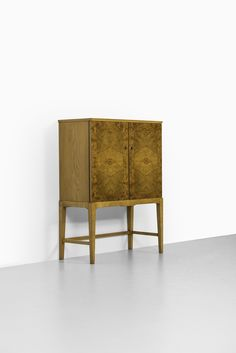 Mid century cabinet in burlwood at Studio Schalling
