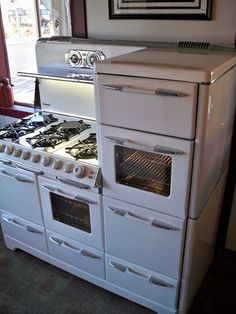 "O'Keefe & Merritt Town and Country  HUGE 57"" wide  Six burners  Two full size ovens wih windows  Two full size broilers  Two storage drawers  Two warming compartments"