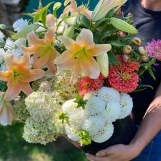 """This bulk bucket was a custom harvest in whites, creams, peaches and apricots. Our buckets of blooms include approximately 60 stems. We included a mix of foliages/greenery, accent flowers and """"feature"""" flowers, harvested from what is most beautiful and abundant in our flower field. These flowers come in buckets of water and typically fill 8-10 mason jars depending on how you design your arrangements. Bulk Wedding Flowers, Diy Wedding, Flower Farm, Buckets, Stems, Peaches, Greenery, Harvest, Mason Jars"""