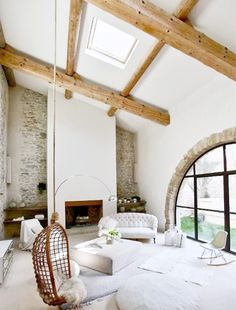 wooden beams, arched windows + stone walls - loving this rustic-meets-modern mix