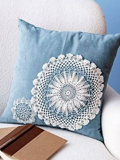 Pretty up a sad pillow by adding a touch of lace. You'll need good-condition crocheted fabric doilies of various shapes and sizes — check your linen closet, or find inexpensive ones at thrift shops or on eBay