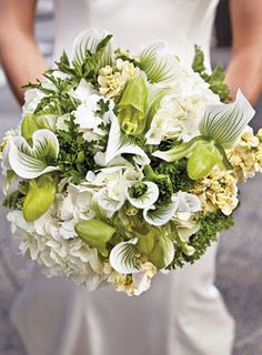 Bridal Bouquet of lady's slipper orchids, scented geraniums, hydrangeas, curly green ranunculuses, and stock, Wedding Ideas | Brides.com : Brides