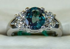 Ok, I seriously like Alexandrite as the big stone better than diamond... I love love love this. Drooling right now