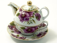 Purple Pansy Tea for One-Tea Pot, Tea Cup/Saucer Set by Popular Creations, http://www.amazon.com/dp/B0049UI5CM/ref=cm_sw_r_pi_dp_l3drqb0T72N3R