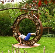Beautiful garden piece.  I wonder if I could talk my husband into making me this?  Or teaching me to weld so I can make it myself...