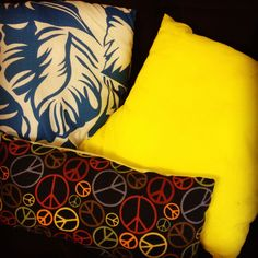 Finished pillows!  The yellow is the back to the blue and white patterned pillow.