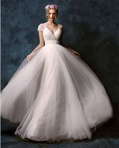 Chic wedding dress! Love the tulle and the capped sleeves <3 Ethereal wedding dress