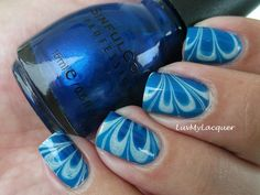 Blue water marble nail art over Sinful Colors Cinderella manicure. #Nails www.SimpleNailArtTips.com