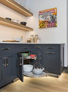 A blind-corner shelf swings out to maximize storage in hard-to-reach corner cabinets. Corner Cabinets, Upper Cabinets, Kitchen Cabinets, Kitchen Stuff, New Kitchen, Kitchen Ideas, Laminate Cabinets, Bright Walls, Cedar Park