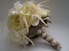 FRENCH  VANILLA CREME Wedding Bouquet With Guinea Feathers. $110.00, via Etsy.