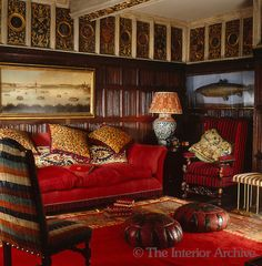 Robert Kime ~ A carved gilt-frieze with a variety of crests runs around the ceiling of this wood-panelled sitting room