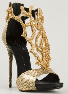 Jennifer Lopez Flaunts Cleavage in Mini Dress and Giuseppe Zanotti Heels