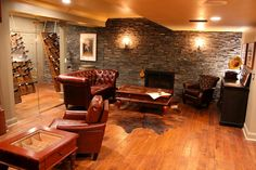 Luxurious Man-Cave/Smoking Room with creatively displayed wine collection, and tables designed to not only display cigars, but keep them perfectly fresh...