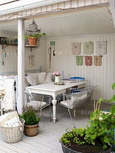 Under-deck sleeping room - love the white! Roll down screen to protect from rain and while not being used.