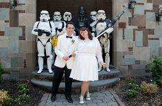 A surprise Delorean time machine for the groom, a processional with Darth Vader for the bride, a custom kitty-loving cake topper, and so many Stormtroopers — this geeky wedding is stealing ou…