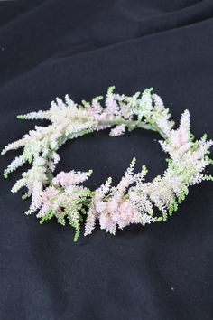 Pink astilbe floral crown for a flower girl in a wedding.