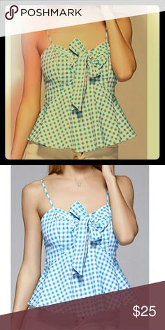 "Strappy Gingham Bow Flounce Top Adorable strappy top in blue and white gingham pattern. Cute bow at the chest and flared around the hips for a unique silhouette. Perfect for summer picnics and al fresco dinners. Go from day to night by throwing a cardigan over it. Would go excellent with the white midi sheath skirt listed! NOT Voodoo Vixen.  Model is 5'9"", 109 lbs, bust 33, waist 23, hips 35, shoulders 15. Wearing a medium. Voodoo Vixen Tops Tank Tops"