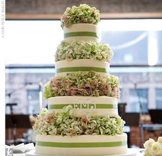 four-tiered cake frosted with ivory buttercream, filled with layers such as white marble cake with Bavarian cream filling.