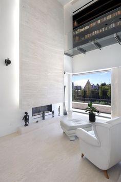 white modern two-story fireplace  inspiration #stone #fireplace